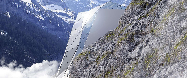 Spectaculair hotel van glas op het topje van de Alpen
