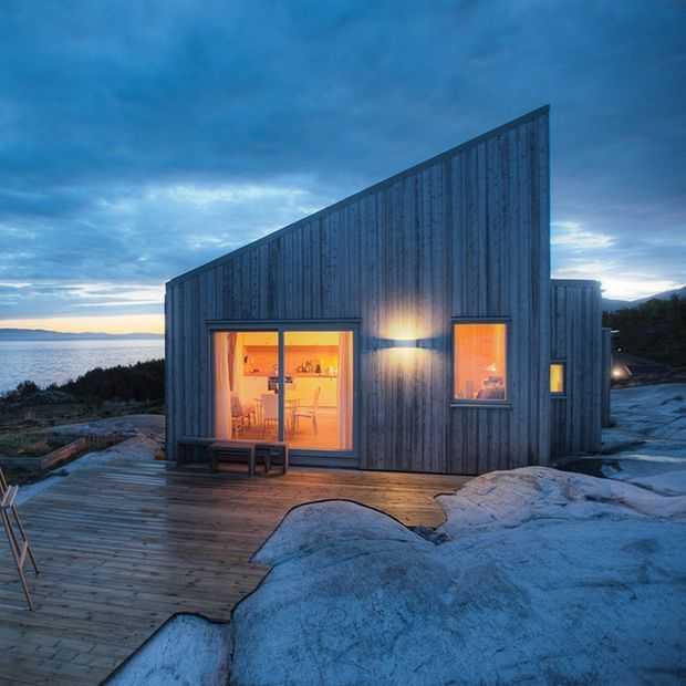 Droomhuis in Noorwegen: handgemaakt van dennenbomen uit eigen bos